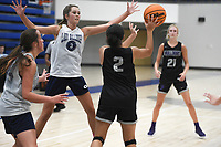 Fayetteville's Whitney Brown (2) passes as Greenwood's Anna Trusty (3) covers, Thursday, June 10, 2021 during a basketball game at Rogers High School in Rogers. Check out nwaonline.com/210611Daily/ for today's photo gallery. <br /> (NWA Democrat-Gazette/Charlie Kaijo)