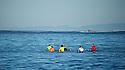 Grant Washburn (green), Chris Bertish (red), Jamie Sterling (white), Shawn Dollar (orange), Nathan Fletcher (yellow) and Matt Ambrose (blue) wait for a wave during Heat 2 Mavericks Invitational 2012/1013