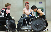 27 MAY 2013 - DONCASTER, GBR - David Anthony (centre) of the South Wales Pirates battles to keep the ball during the 2013 Great Britain Wheelchair Rugby Nationals bronze medal match against West Coast crash at The Dome in Doncaster, South Yorkshire .(PHOTO (C) 2013 NIGEL FARROW)