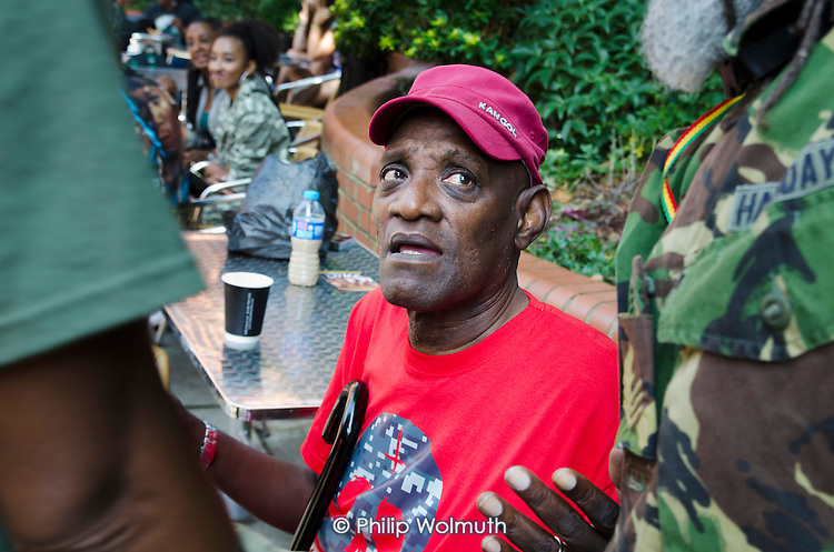 Darcus Howe, writer, broadcaster and social commentator, at the mas camp of the Mangrove carnival band, of which he was a founder member, Notting Hill Carnival 2013.
