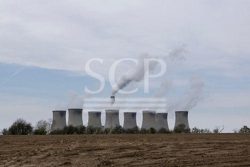 Cottam coal-fired Power Station, near Retford, Nottinghamshire. View of the eight cooling towers and chimney looking west from Torksey.
