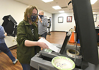 EARLY VOTING<br />Christine Erwin-Jimenez casts her ballot on Tuesday April 6 2021 at the Benton County Clerk's Office in Bentonville during early voting for the Bentonville bond election. Voters are being asked to approve $266 million in bonds for various projects, including street and park improvements. Early voting takes place today, Thursday, Friday and Monday at the county clerk's office in the county administration building downtown. The general election day is Tuesday. Go to nwaonline.com/210407Daily/ to see more photos.<br />(NWA Democrat-Gazette/Flip Putthoff)
