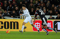 (L-R) Ki Sung Yueng of Swansea chased by Etienne Capoue of Watford during the Barclays Premier League match between Swansea City and Watford at the Liberty Stadium, Swansea on January 18 2016