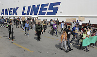 Pictured: Protesters marching next to a ship in Piraeus port Tuesday 08 March 2016<br /> Re: Afghan migrants hold a protest at Piraeus port, near Athens, Greece.