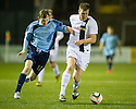 Ayr Utd's Kevin Kyle tries to get away from Forfar's Neil McCabe.