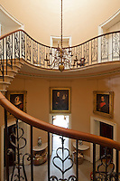 View of the stone flagged entrance hall from half way up the cantilevered staircase