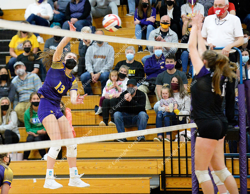 DeForest's Reese Yocum hits over the net, as DeForest tops Waunakee 3 sets to 1 in Wisconsin WIAA girls high school volleyball regional finals on Saturday, Apr. 10, 2021 at DeForest High School