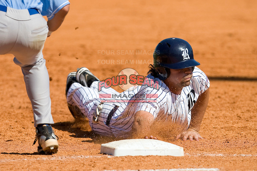 Rice Owls outfielder Michael Fuda #15 dives back to first base following a pick off attempt against the Memphis TIgers in NCAA Conference USA baseball on May 14, 2011 at Reckling Park in Houston, Texas. (Photo by Andrew Woolley / Four Seam Images)