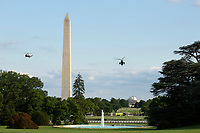 Marine One, with United States President Donald J. Trump aboard, prepares to land on the South Lawn of the White House in Washington, D.C., U.S., on Sunday, June 14, 2020.  Trump tweeted that he will not watch the NFL or the U.S. Soccer Federation if either organization allows players to kneel during the playing of the American National Anthem.  <br /> Credit: Stefani Reynolds / Pool via CNP/AdMedia