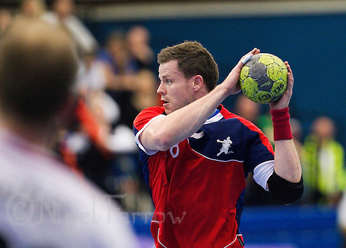08 JAN 2012 - LONDON, GBR - Great Britain playmaker Daniel Mcmillan looks for a way through the Austrian defence during the men's 2013 World Handball Championships qualification match against Austria at the National Sports Centre in Crystal Palace, Great Britain (PHOTO (C) 2012 NIGEL FARROW)