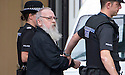 EXCLUSIVE PIC : Angus Sinclair is taken from Livingston High Court to a waiting car to be taken on a site visit to locations in East Lothian relating to his trial .. <br />    <br /> Angus Sinclair is on trial accused of murdering two teenagers, Helen Scott and Christine Eadie, who were last seen on a night out at the World's End pub on Edinburgh's Royal Mile Edinburgh in October 1977.