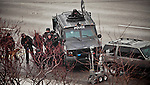 standoffp1, mjs, news - A tactical team stands behind their armored truck as their robot breaks the back window of the SUV that sat on I-94 westbound for six hours, in Milwaukee on Friday, December 10, 2010. PHOTO BY MARK ABRAMSON/MABRAMSON@JOURNALSENTINEL.COM
