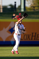 Jake Shaffer (31) of the Springfield Cardinals catches a ball hit to left field during a game against the Northwest Arkansas Naturals at Hammons Field on June 14, 2012 in Springfield, Missouri. (David Welker/Four Seam Images)