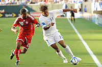 Carlo Costly (13) of Honduras (HON) is defended by Patrice Bernier (20)of Canada (CAN). Honduras (HON) defeated Canada (CAN) 1-0 during a quarterfinal match of the CONCACAF Gold Cup at Lincoln Financial Field in Philadelphia, PA, on July 18, 2009.