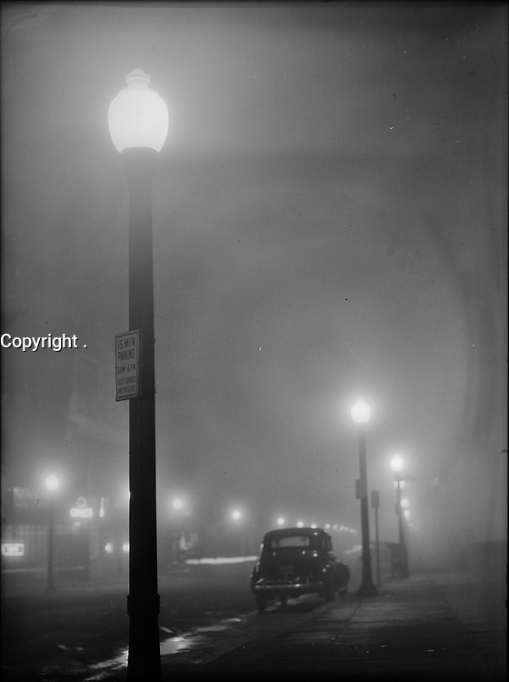 On Little Cat Feet: Foggy Night street scene in New Bedford, Massachusetts, 1940.<br /> <br /> Photo by Jack Delano.