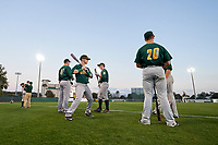 Siena Saints Joe Drpich (47), Dan Lowndes (8), Justin Bishop (4), and Alex Tuccio (20) in the outfield before a game against the Stetson Hatters on February 23, 2016 at Melching Field at Conrad Park in DeLand, Florida.  Stetson defeated Siena 5-3.  (Mike Janes/Four Seam Images)
