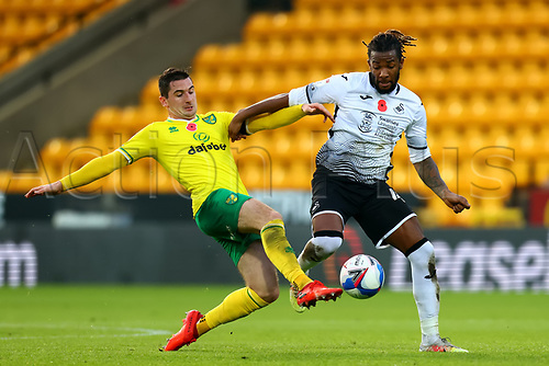 7th November 2020; Carrow Road, Norwich, Norfolk, England, English Football League Championship Football, Norwich versus Swansea City; Kenny McLean of Norwich City challenges Kasey Palmer of Swansea City