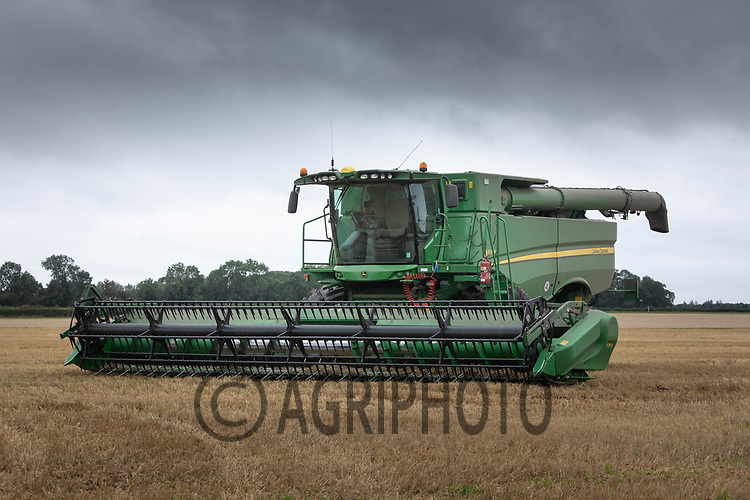 3.9.2020 A John Deere combine parked up under dark storm clouds in Lincolnshire <br /> ©Tim Scrivener Photographer 07850 303986<br />      ....Covering Agriculture In The UK.