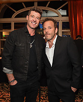 2020 FOX WINTER TCA: L-R: THE MASKED SINGER panelist Robin Thicke and DEPUTY cast member Stephen Dorff celebrate at the FOX WINTER TCA ALL-STAR PARTY during the 2020 FOX WINTER TCA at the Langham Hotel, Tuesday, Jan. 7 in Pasadena, CA. © 2020 Fox Media LLC. CR: Frank Micelotta/FOX/PictureGroup