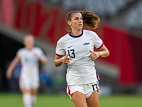 TOKYO, JAPAN - JULY 21: Alex Morgan #13 of the USWNT sprints during a game between Sweden and USWNT at Tokyo Stadium on July 21, 2021 in Tokyo, Japan.