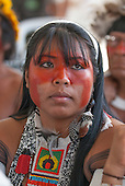 Mayalú Txucarramãe, a Kayapo woman, listens to discussions amongst indigenous people at the indigenous forum. The People's Summit at the United Nations Conference on Sustainable Development (Rio+20), Rio de Janeiro, Brazil, 18th June 2012. Photo © Sue Cunningham.