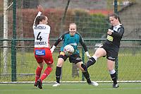 Ella Vierendeels (4) of Zulte Waregem with Goalkeeper Lisa Vandeputte (1) of Eendracht Aalst and Valentine Hannecart 8) of Eendrcht Aalst  pictured during a female soccer game between SV Zulte - Waregem and Eendracht Aalst on the 9 th matchday in play off 2 of the 2020 - 2021 season of Belgian Scooore Womens Super League , saturday 22 nd of May 2021  in Zulte , Belgium . PHOTO SPORTPIX.BE | SPP | DIRK VUYLSTEKE