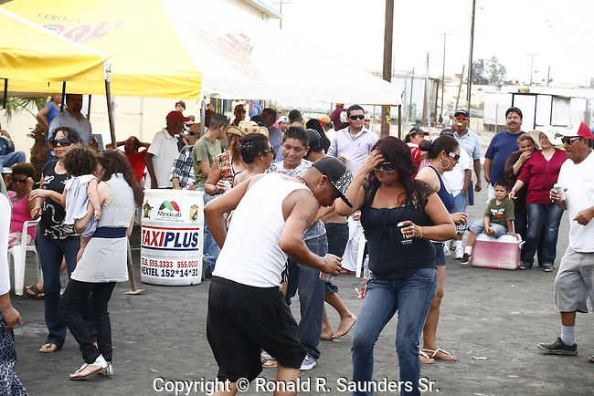 Revelers dance outdoors during the Navy Day holiday