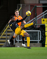 2nd October 2020; Tannadice Park, Dundee, Scotland; Scottish Premiership Football, Dundee United versus Livingston; Efe Ambrose of Livingston clears overhead from Lawrence Shankland of Dundee United