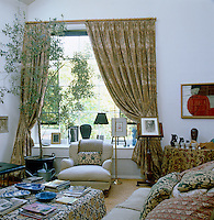A large window dominates the comfortable living room in this former artist's studio