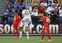 Megan Rapinoe #15 of the USA WNT celebrates her goal between Gaoping Zhou #20 and Yasha Gu #24 of the PRC WNT during an international friendly match at KSU Soccer Stadium, on October 2 2010 in Kennesaw, Georgia. USA won 2-1.