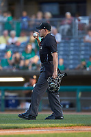 Home plate umpire Kelvis Velez brings a new baseball to the pitcher during the South Atlantic League game between the Lexington Legends and the West Virginia Power at Appalachian Power Park on June 7, 2018 in Charleston, West Virginia. The Power defeated the Legends 5-1. (Brian Westerholt/Four Seam Images)