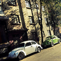 Classic Volkswagen beetle cars ('vochos') are seen parked on the street in Mexico City, Mexico, 6 November 2014.