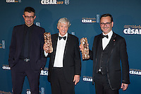 """Director Paul Verhoeven (C) poses with film producers Said Ben Said and Michel Merkt during a photocall after receiving the Best Film Award for his film """"Elle"""" at the 42nd Cesar Awards ceremony in Paris, France, February 24, 2017."""