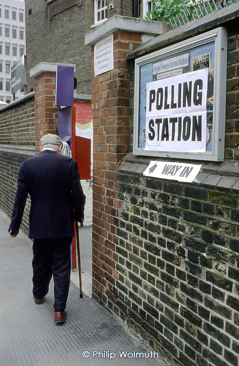 An elderly man enters a polling station in a school in Camden, London, during the 1997 General Election.