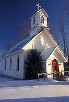 church, chapel, Vermont, VT, The Cavalry Episcopal Church with Christmas wreaths on the red doors in the village of Underhill in the snow in winter.