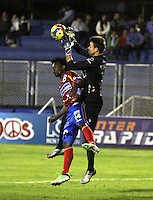 PASTO - COLOMBIA -24-03-2014: Mike Campaz (Izq.) jugador de Deportivo Pasto disputa el balón con Leonardo Burian (Der.) portero del Deportes Tolima durante partido Deportivo Pasto  y Deportes Tolima por la fecha 6 de la Liga Postobon II 2014, jugado en el estadio Libertad de la ciudad de Pasto.  / Mike Campaz (L) player of Deportivo Pasto fights for the ball with Leonardo Burian (R) goalkeeeper of Deportes Tolima during a match Deportivo Pasto and Deportes Tolima for the date 6 of the Liga Postobon II 2014 at the Libertad stadium in Pasto city. Photo: VizzorImage  / Leonardo Castro / Str.