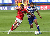 Josh Cullen of Charlton Athletic and Reading's Andy Rinomhota challenge for the ball during Charlton Athletic vs Reading, Sky Bet EFL Championship Football at The Valley on 11th July 2020