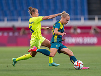 TOKYO, JAPAN - JULY 24: Filippa Angeldal #16 of Sweden fights for the ball with Tameka Yallop #13 of Australia during a game between Australia and Sweden at Saitama Stadium on July 24, 2021 in Tokyo, Japan.