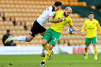 20th February 2021; Carrow Road, Norwich, Norfolk, England, English Football League Championship Football, Norwich versus Rotherham United; Lewis Wing of Rotherham United competes for the ball with Teemu Pukki of Norwich City