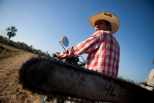 A laborer on the way to cut trees for ranch fences at an illegal settlement in the Mayan Biosphere.