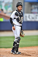 Asheville Tourists catcher Joel Diaz (5) during a game against the Rome Braves at McCormick Field on June 25, 2017 in Asheville, North Carolina. The Braves defeated the Tourists 7-2. (Tony Farlow/Four Seam Images)