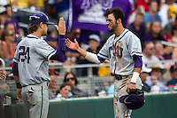 TCU Horned Frogs outfielder Dane Steinhagen (10) is greeted by teammate Connor Beck (24) after scoring against the LSU Tigers in the NCAA College World Series on June 14, 2015 at TD Ameritrade Park in Omaha, Nebraska. TCU defeated LSU 10-3. (Andrew Woolley/Four Seam Images)