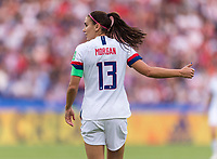 PARIS,  - JUNE 28: Alex Morgan #13 yells to a teammate during a game between France and USWNT at Parc des Princes on June 28, 2019 in Paris, France.
