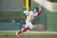Simon Muzziotti (12) of the Lakewood BlueClaws scampers back to first base during the game against the Kannapolis Intimidators at Kannapolis Intimidators Stadium on April 5, 2018 in Kannapolis, North Carolina.  The Intimidators defeated the BlueClaws 4-3.  (Brian Westerholt/Four Seam Images)