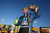 Feb 8, 2015; Pomona, CA, USA; NHRA funny car driver Matt Hagan celebrates after winning the Winternationals at Auto Club Raceway at Pomona. Mandatory Credit: Mark J. Rebilas-