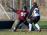 LITCHFIELD, CT-111820JS09—Shepaug Haillie Collette (95) stops a shot by Wamogo's Kaleigh Langlais (30) during their field hockey game Wednesday at Wamogo High School. <br />  Jim Shannon Republican-American