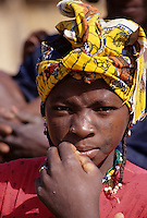 Delaquara, Niger. Young Fulani Woman.  Note facial tattoos on cheeks and around edges of mouth, plus the tiny piece of straw holding the place for a nose-ring.