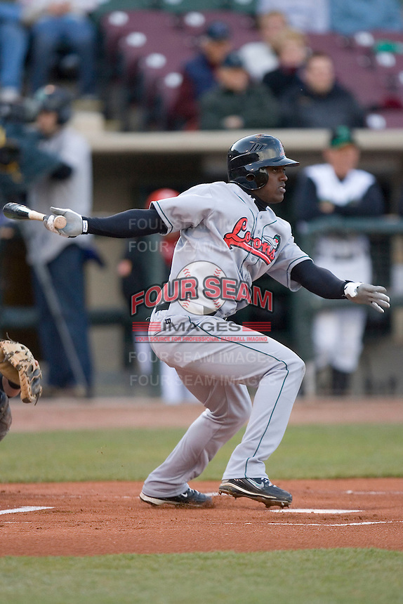 Elian Herrera #15 of the Great Lakes Loons follows through on his swing versus the Dayton Dragons at Fifth Third Field April 22, 2009 in Dayton, Ohio. (Photo by Brian Westerholt / Four Seam Images)