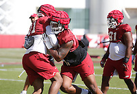 Eric Gregory participates in a tackling drill during the University of Arkansas Razorback Spring football practice Thursday, April 1, 2021, at the University practice field on the campus in Fayetteville. Check out nwaonline.com/210402Daily/ and nwadg.com/photos for a photo gallery.<br /> (NWA Democrat-Gazette/David Gottschalk)
