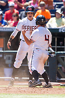 Oregon State Beavers outfielder Max Gordon #4 celebrates with second baseman Andy Peterson #14 after scoring a run during Game 5 of the 2013 Men's College World Series between the Oregon State Beavers and Louisville Cardinals at TD Ameritrade Park on June 17, 2013 in Omaha, Nebraska. The Beavers defeated the Cardinals 11-4. (Brace Hemmelgarn/Four Seam Images)